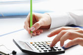 Financial data analyzing. Counting on calculator. — Foto Stock