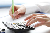 Financial data analyzing. Counting on calculator. — Stockfoto