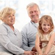 Grandparents laughing with granddaughter — Stock Photo