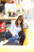 Relaxed female executive in office — Stock Photo