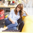 Relaxed female executive in office — Stockfoto