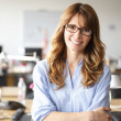 Smiling businesswoman in office — Foto de Stock