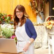 图库照片: Small Business Flower Shop Owner