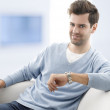 Young man sitting on sofa — Stock Photo #31457593