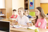 Children are sitting in the classroom — Stock Photo