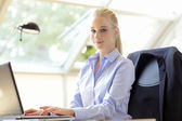 Beautiful business woman with laptop — Stock Photo