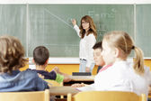 Teacher and student in lesson — Stock Photo