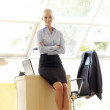 Attractive businesswoman with her arms crossed — Stock Photo