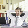 Relaxed Young Businessman — Stock Photo #32063727