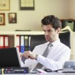 Young businessman working on laptop — Stock Photo #32063749