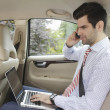 Businessman working in his car — Stock Photo #32580919