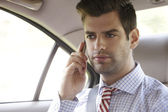 Businessman in his car — Stock Photo
