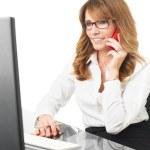 Businesswoman talking on mobile phone — Stock Photo
