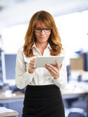 Modern business woman holding tablet — Stock Photo