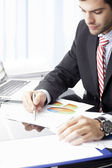 Businessman sitting and working — Stock Photo