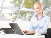 Businesswoman working in her office — Stock Photo