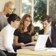 Positive businesswoman sitting with her team — Stock Photo #33984727