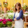 Foto de Stock  : Smiling WomFlorist, Small Business Flower Shop Owner