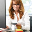 Stock Photo: Mature business womonline shopping