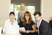 Positive businesswoman sitting with her team — Stockfoto