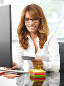 Mature business woman online shopping — Stok fotoğraf