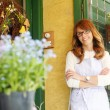 Stock Photo: Smiling Woman Florist