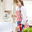 Happy woman cooking — Stock Photo