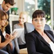 Businesswoman with colleagues — Stock Photo #35098273