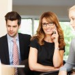 Businesswoman with colleagues — Stock Photo #35098319