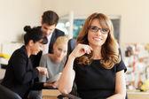 Female executive smiling — Stock Photo