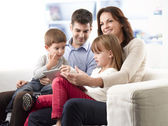 Happy family with tablet pc — Stock Photo