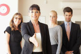 Businesswoman going to shake your hand — Stock Photo