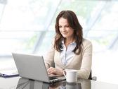 Beautiful business woman with laptop — Stock Photo