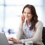 Beautiful businesswoman having a phone conversation — Stock Photo #39088179