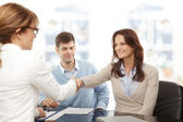 Financial advisor and client handshaking — Stock Photo