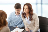 Young couple discussing financial plan with consultat — Foto Stock