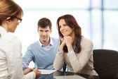 Young couple discussing financial plan with consultat — Foto de Stock