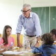 Teacher In Classroom — Stock Photo #39338731