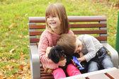 Cute kids loving their dog — ストック写真