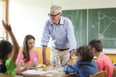 Učitel ve třídě — Stock fotografie