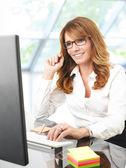 Professional businesswoman working on laptop — Stock Photo