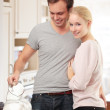 Young couple cooking in the kitchen together — Stock Photo