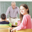 Elementary classroom setting. Focus on school girl. — Zdjęcie stockowe #40248747