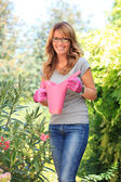 Happy mature woman in garden — Foto de Stock