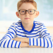 Young student sitting at desk — Stock Photo #40613359