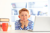 Young student sitting at desk — Stock Photo