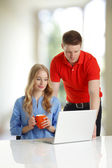 Young couple browsing together on a laptop — Stock Photo