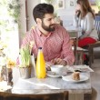 Stock Photo: Modern young msitting in coffee shop