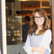 Woman standing in front of coffee shop — Stock Photo #41260971