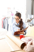 Beautiful fashion designer working — Stock Photo
